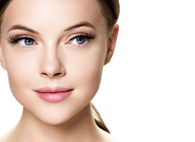 Beautiful woman face with eyelashes beauty healthy skin natural